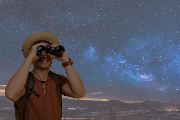man with binoculars for stargazining, how good are binoculars for astronomy